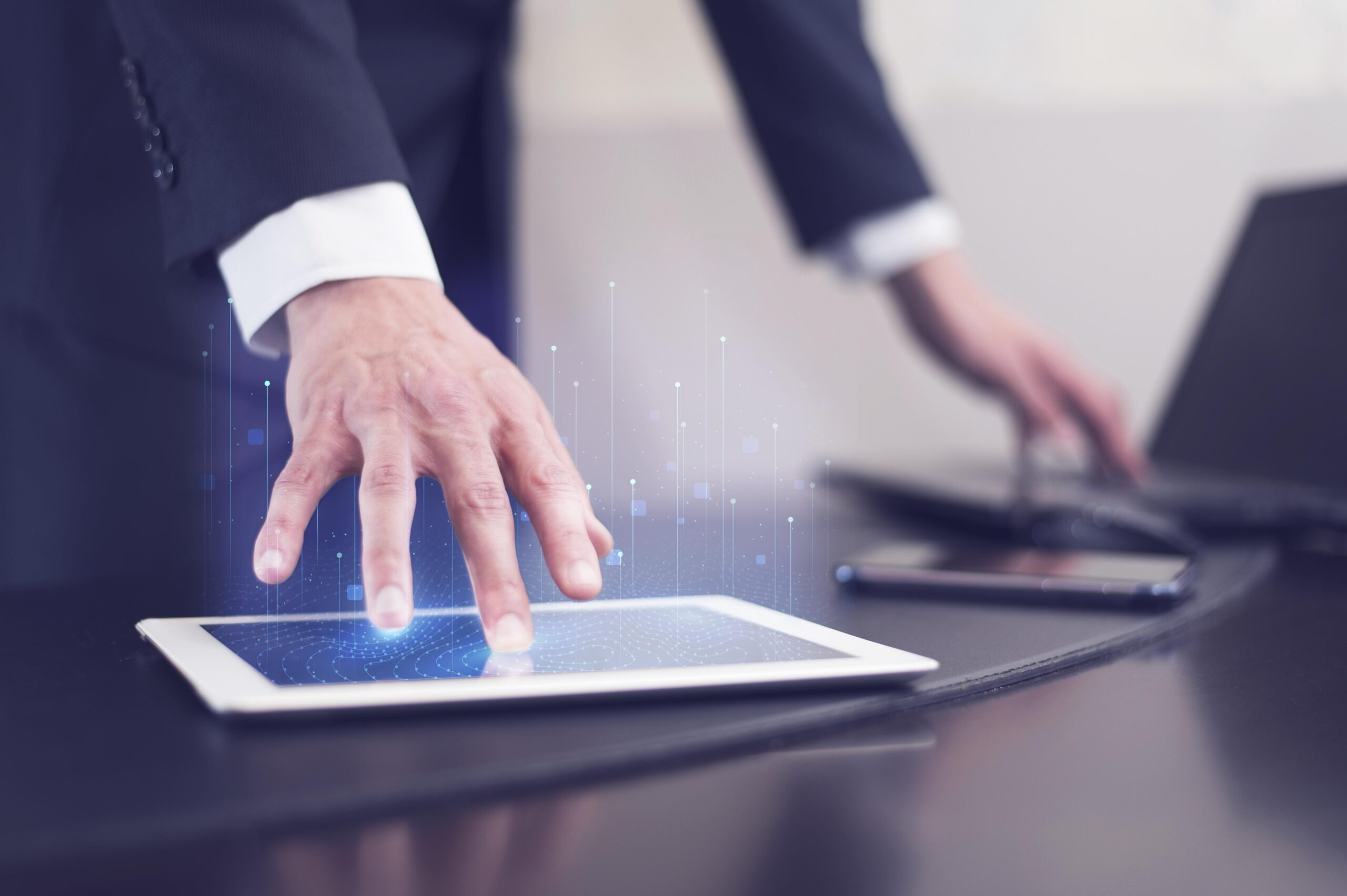 side-view-businessman-using-technology-tablet
